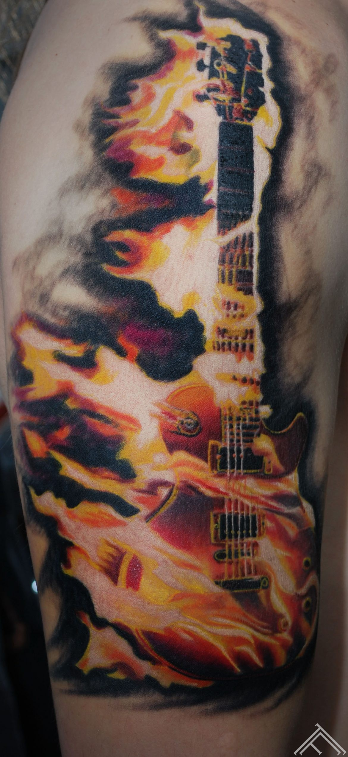 burning-fire-guitar-tattoo-tattoofrequency-tattoostudio-saloon-riga