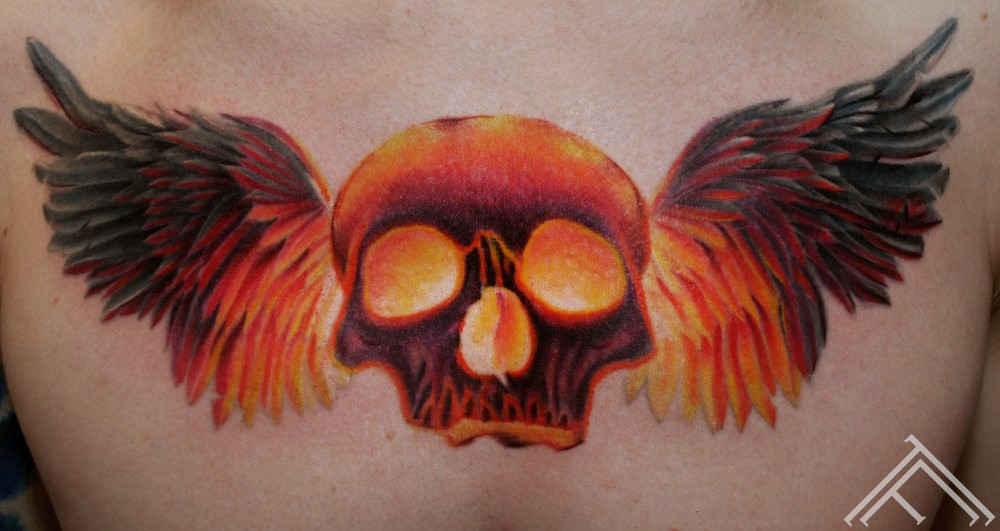 burning-skull-wings-marispavlo-tattoo-tattoofrequency-frequency-riga-tattoostudio