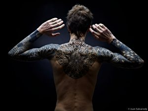 Guy with back tattoos