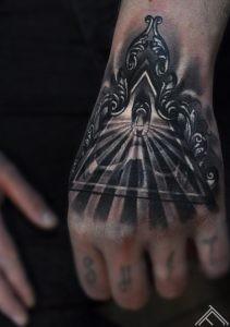 skull_triangle_baroque_keyhole_shining_light_tattoo_marispavlo_tattoofrequency_riga