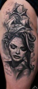 upperleg-area-tattoo-tattoofrequency-woman-portrait-ship-octopus-sexy-compass-girl-marispavlo-cut