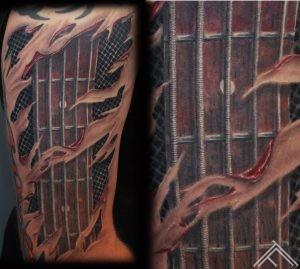 tattoo_bass_guitar_strings_tattoofrequency_tattooshop_rigasaloon_tattoostudio
